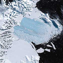 Thousands of icebergs float off the coast of the Antarctic Peninsula after 1,250 square miles (3,240 square kilometers) of the Larsen B ice shelf disintegrated in 2002.